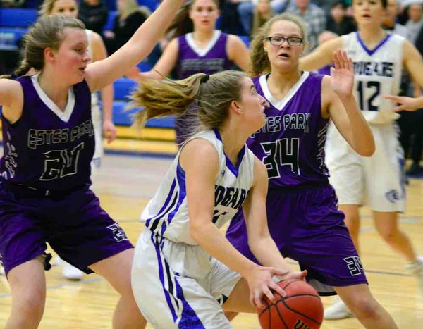 Elisabeth Perl drives into the lane against Estes Park at Resurrection Christian High School on Feb. 12. (Photo by Quinn Ritzdorf)