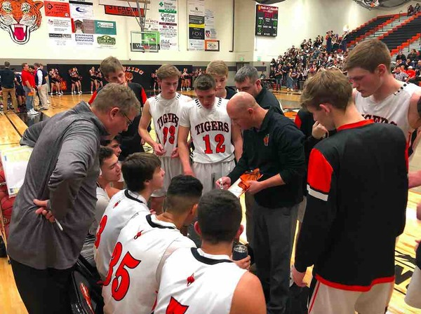 Sterling's coach Mike Holloway draws up a play during a timeout against Kent Denver at Sterling High School on Jan. 26. (Photo by Quinn Ritzdorf)