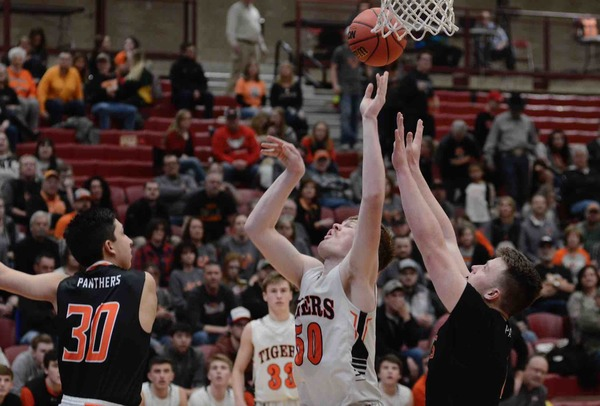 Sterling's Jace Pittman, center, shoots a layup against Montezuma-Cortez in the Class 3A Boys Basketball Championships at University of Denver. (Photo by Quinn Ritzdorf)