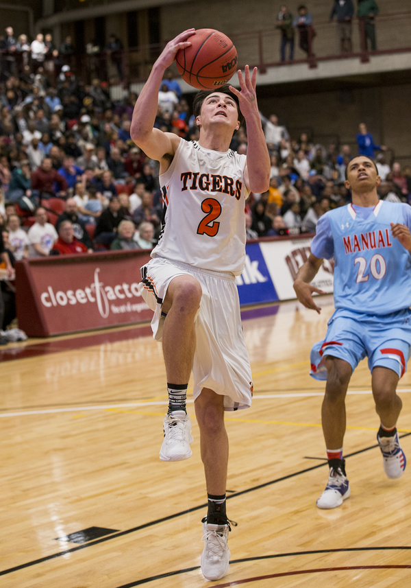 Sterling's Colton Shalla, left, gets a breakaway to the basket against Manual on Friday in the semifinals of the Class 3A Boys Basketball Championships at the University of Denver's Hamilton Gymnasium. (Michael Brian/mbrian@greeleytribune.com)