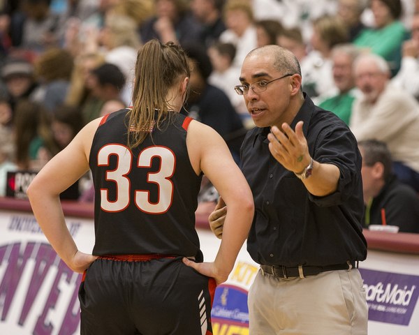 Eaton coach Todd Hernandez, right, talks with Jennifer Jarnagin on Friday during the semifinals of the Class 3A Girls Basketball Championships at the University of Denver's Hamilton Gymnasium. (Michael Brian/mbrian@greeleytribune.com)