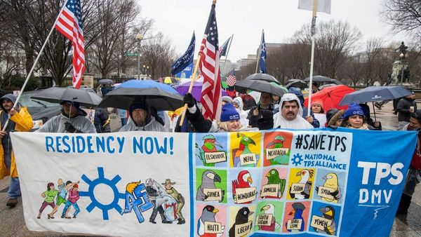 Demonstrators in Washington last month urge Congress to enact permanent protections for recipients of temporary protected status, or TPS. (Shawn Thew / EPA/Shutterstock)