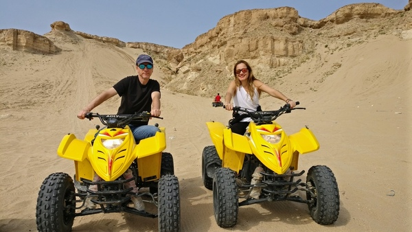 Tod and Tatiana on rented fully automatic ATV four wheelers.