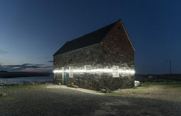 Diese Lichtinstallation zeigt, wie stark sich der Wasserstand durch die Erderwärmung verändert