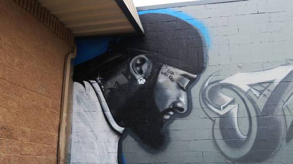 Inspired Fresno artists create popular murals of late rapper Nipsey Hussle around town | The Fresno Bee