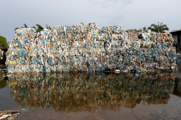 Plastic waste piled outside an illegal recycling factory in Jenjarom, Malaysia