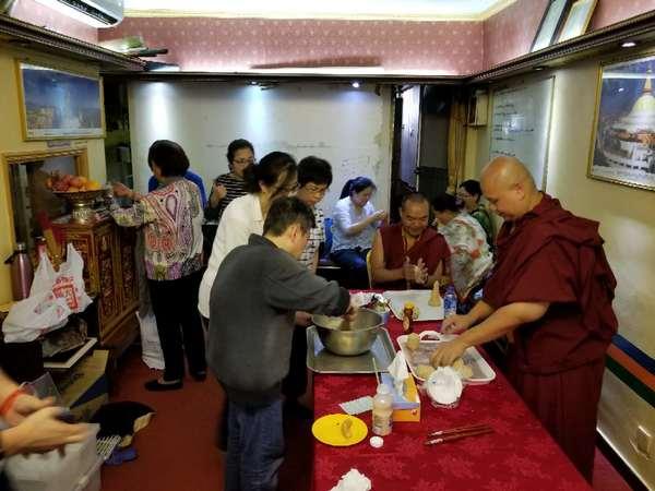 Drupla Sönam Tsering and Lama MC preparing the puja in Hong-Kong