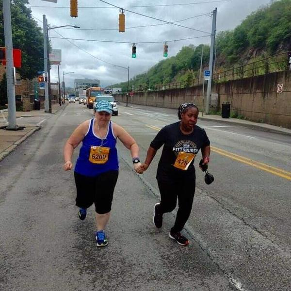 The last two runners in the Pittsburgh Marathon not letting each other quit. Obtain your goal no matter what. ~ /r/GetMotivated