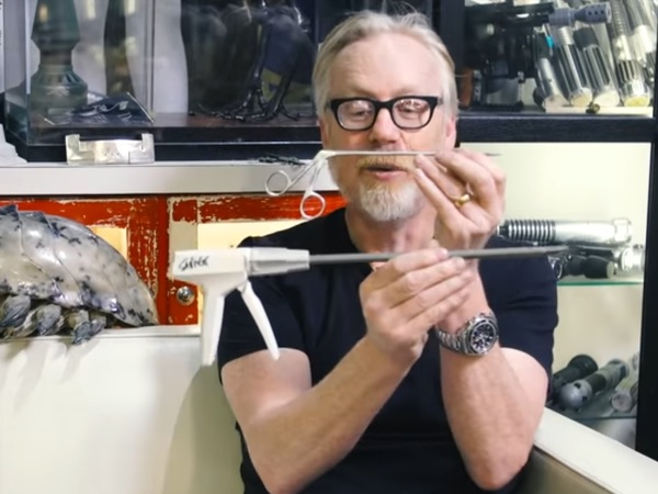 Adam shows off his long-shank surgical reacher tools