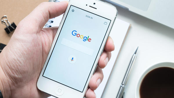 "Google rolling out mobile search redesign with black ""Ad"" label, favicons for organic results"