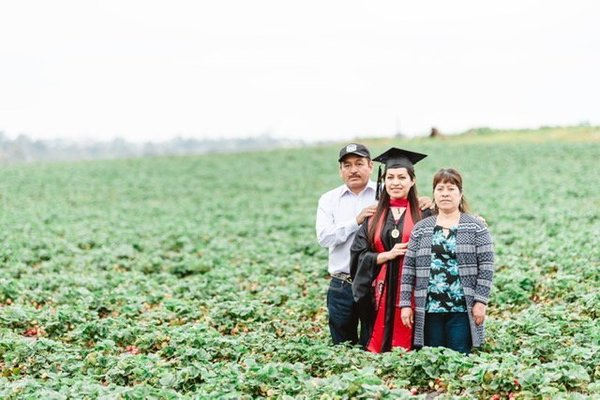 Inspiring photo shows California college grad standing in the fruit fields where her immigrant parents work | WHNT.com