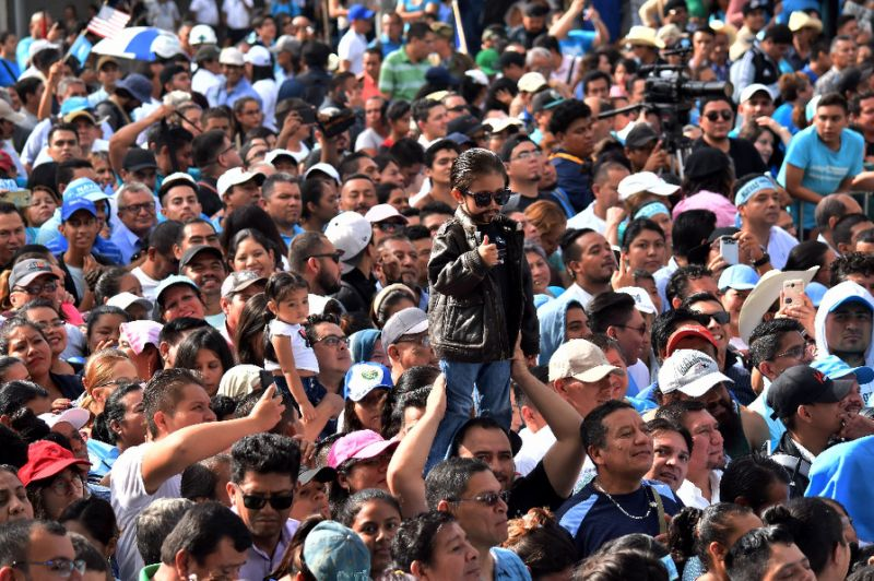 A boy dressed as El Salvador's new president Nayib Bukele is seen amid a crowd of supporters attending the new leader's inauguration ceremony in downtown San Salvador (AFP Photo/Oscar Rivera)