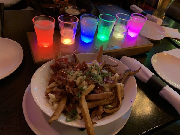The Infinity Shots and Wolverine Poutine at the best bar in Toronto; Storm Crow Manor.