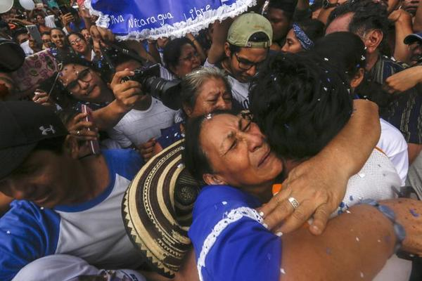 Alfredo Zuñiga, AP. Yubrank Suazo is embraced by his mother Ana Julia Urbina after he was freed from prison, in Masaya, Nicaragua.