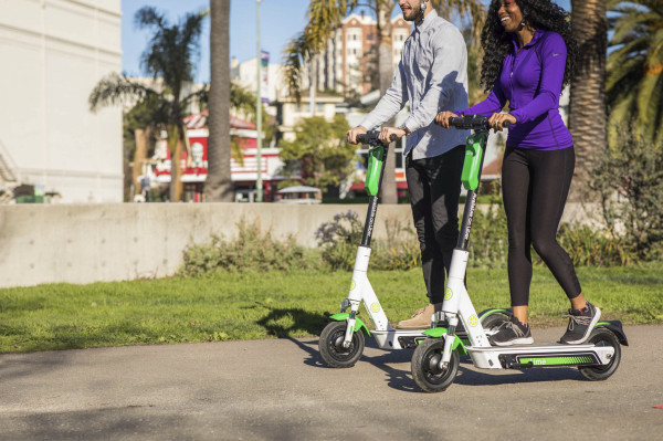 Uber brings bikes and scooters, including Lime's, to the forefront