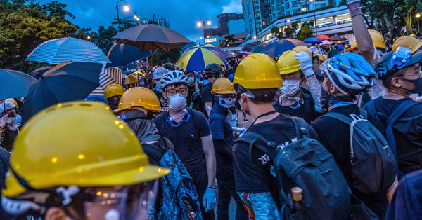 In Hong Kong Protests, Faces Become Weapons