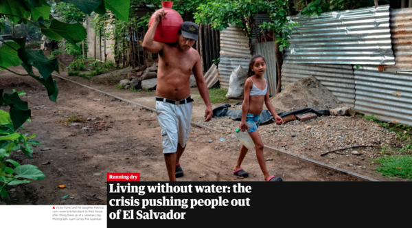 """Victor Funez and his daughter Patricia carry water pitchers back to their house after filling them up at a cemetery tap."" Photograph: Juan Carlos/The Guardian"