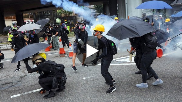 Hong Kong police fire blue-dye water cannon at protesters as banned demo turns violent