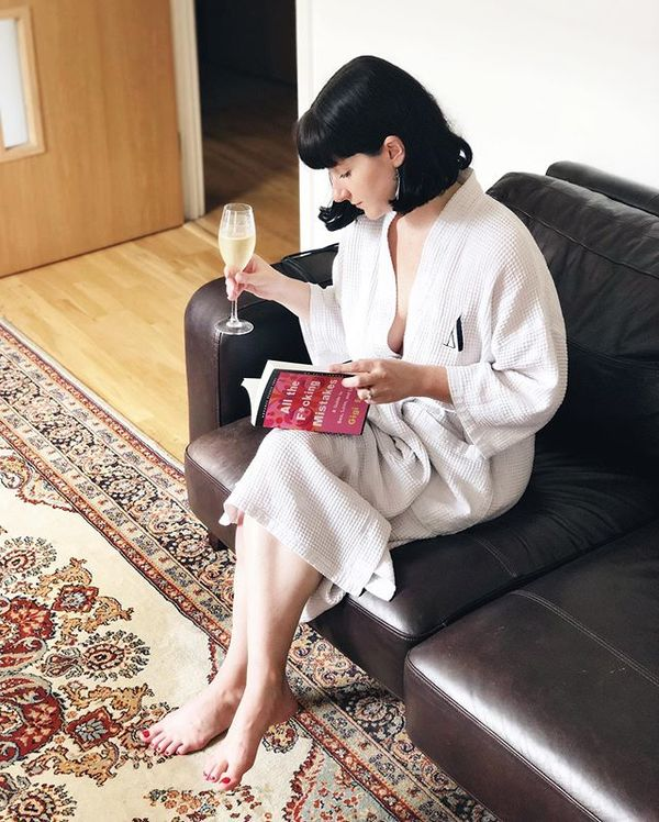 Me reading my book over a glass of champagne. The usual.