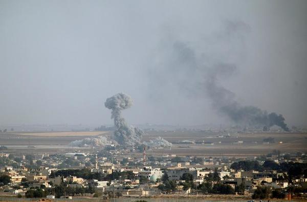 Gevechten bij de Syrische grensplaats Ras al-Ain (foto: Reuters)