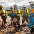 Japan rescuers wade in muddy waters to find typhoon survivors | eNCA