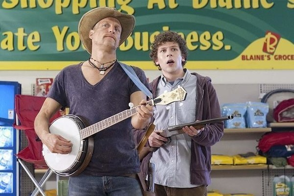 Pictured: Sometimes the only way to make people enjoy your banjo playing is to have a friend with a gun.
