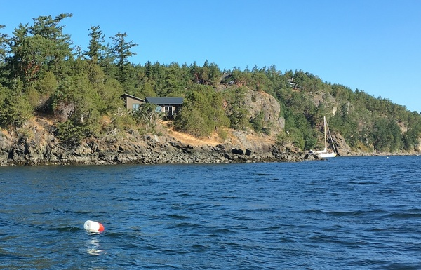 Our crab pot buoy floats in Deer Harbor