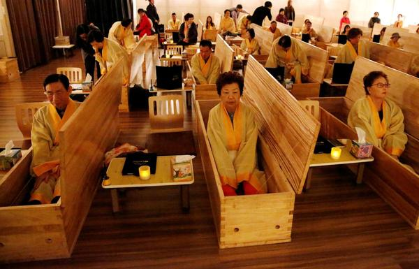 Dying for a better life: South Koreans fake their funerals for life lessons - Reuters