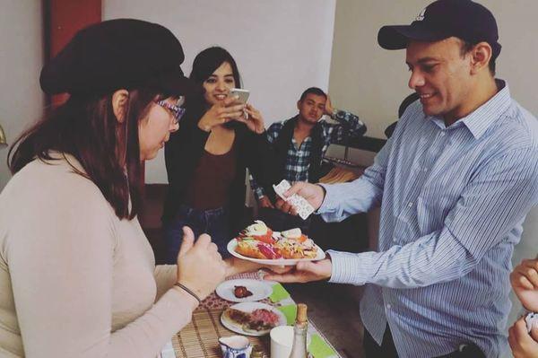 Photo features pupusas and Salvadoran enchiladas.