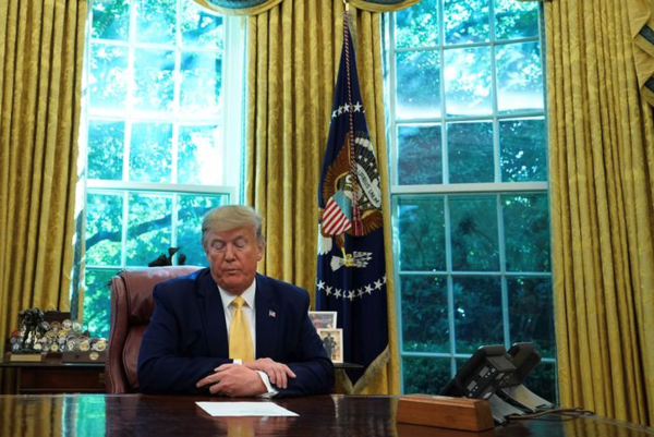 President Trump in het Oval Office (foto: Reuters)