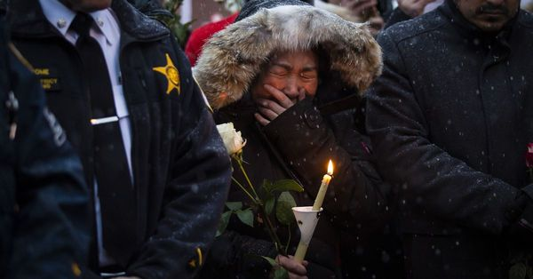 Hundreds in Chinatown plead for 'safe, quiet community' at vigil for 2 men killed in apparent robbery