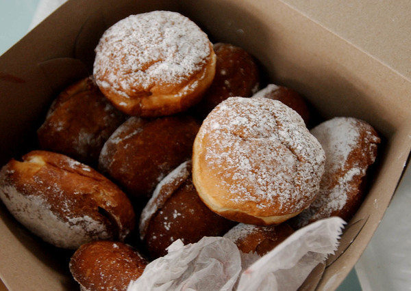 Paczki boxed and ready to go at the Pticek & Sons Bakery on 55th & Naragansett for Paczki Day. | File