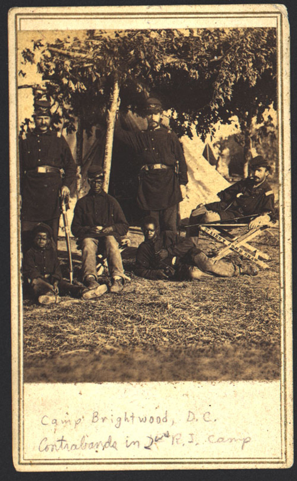"""Captain Beriah S. Brown of Co. H, 2nd Rhode Island Infantry Regiment, Captain John P. Shaw of 1st Rhode Island Infantry Regiment and Co. F, 2nd Rhode Island Infantry Regiment, and Lieutenant T. Fry with three African American boys at Camp Brightwood, Washington, D.C."", 1861"