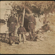 [Captain Beriah S. Brown of Co. H, 2nd Rhode Island Infantry Regiment, Captain John P. Shaw of 1st Rhode Island Infantry Regiment and Co. F, 2nd Rhode Island Infantry Regiment, and Lieutenant T. Fry with three African American boys at Camp Brightwood, Washington, D.C.] | Library of Congress