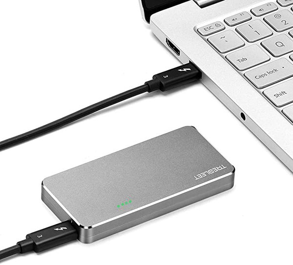 The TREBLEET Thunderbolt 3 SSD Enclosure connected to a laptop