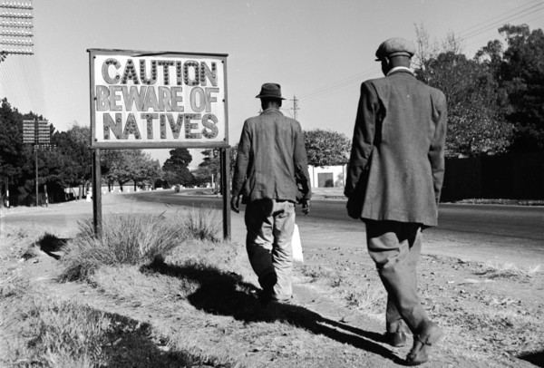 """Some people in South Africa are trying to equate the restrictions being put in place currently to restrict movement, require permits if you work in a sector providing essential services, etc., as the same as those during apartheid. This is a classic example of """"false equivalence"""" as the circumstances are different. However, we need to keep a close eye on some of the regulations being passed during this time. 📷 A sign common in Johannesburg, South Africa, reading 'Caution Beware Of Natives'. Ejor/Getty Images"""