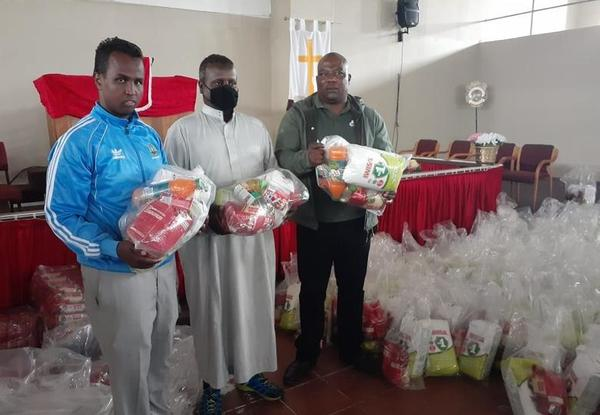 Shop owners donate food parcels to needy families
