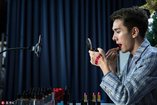 Austin Li testing lipsticks on a livestreaming session