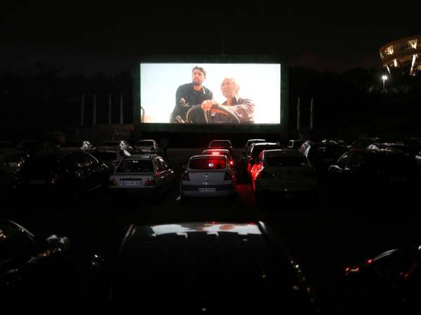 Coronavirus brings first drive-in cinema to Iran since they were banned in 1979 revolution | The Independent