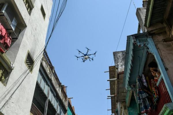 India uses drones to disinfect virus hotspot as cases surge