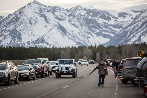 People flock to Yellowstone, Grand Teton national parks on reopening day