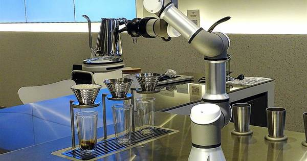 'Your ... coffee ... Sir': pobot waiters part of SKorea move to 'untact' future