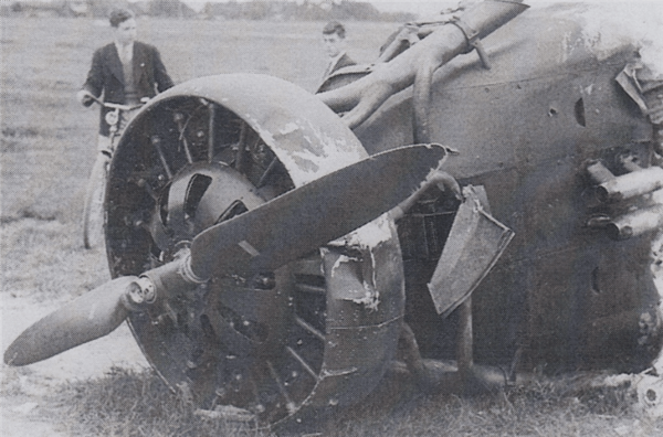 Two English School pupils looking at a crashed German plane in May 1940