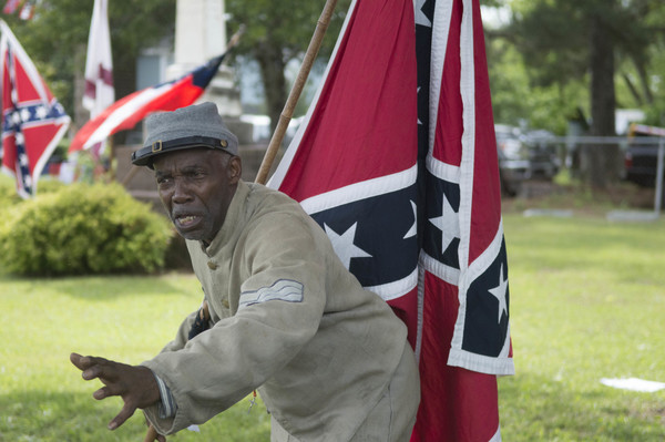 Is that a black man carrying a Dixie flag and soldiering for the Civil War South?