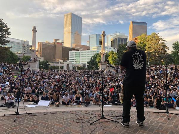 At nearly every turn in Denver, protesters confront a reason to march