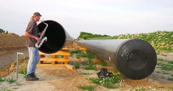Musician Plays Saxophone Into Giant Gas Pipes to Accompany Himself With His Own Echo