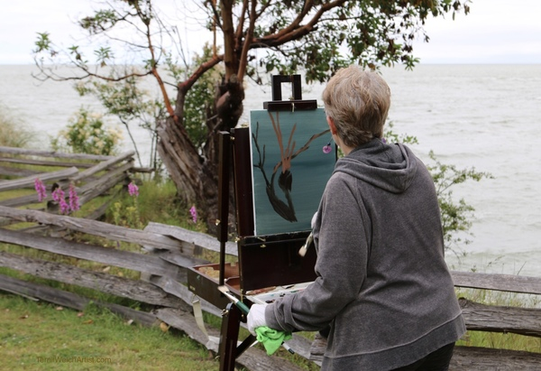 Artist Glenda King placing the first few marks on her plein air canvas.