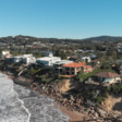 Against the tide: storm-battered residents cling to beachfront homes on Australian east coast
