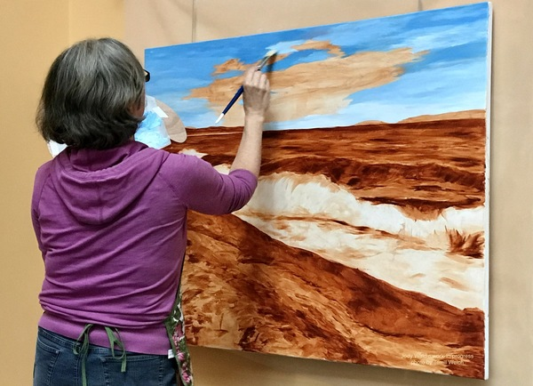 Landscape painter Jody Waldie blocking in oil painting over her underpainting.