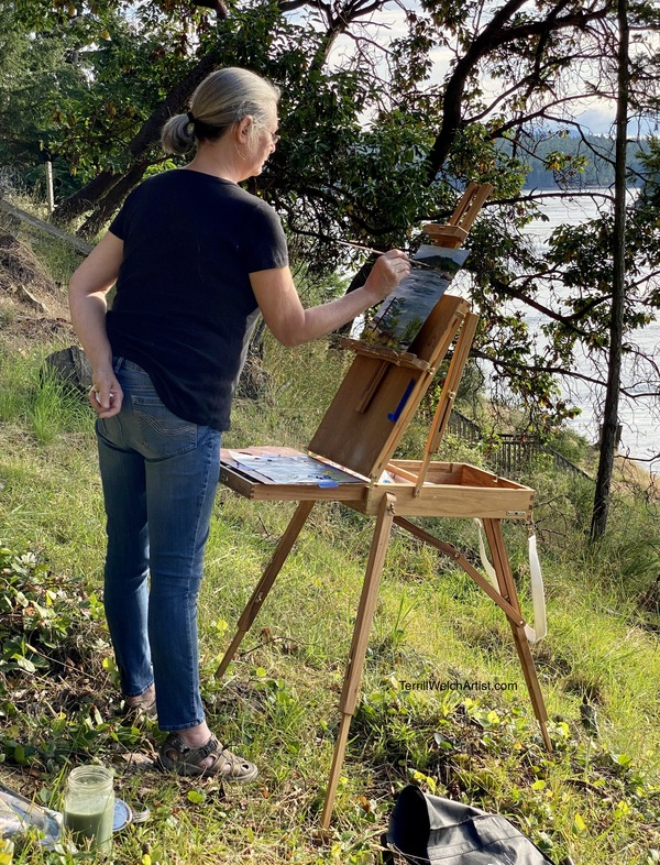 Jody Waldie plein air painting n a steep bank in Active Pass.